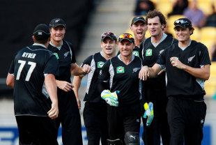 New Zealand gather around Jesse Ryder after he catches Graeme Smith, New Zealand v South Africa, 1st ODI , Wellington, February 25, 2012