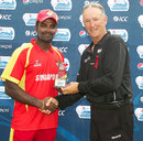 Chaminda Ruwan receives the Player of the match award from Tony Hill, Singapore v Malaysia, ICC World Cricket League Division Five final, Singapore, February 25, 2012