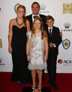 Shane Warne and his children at the Allan Border Medal awards