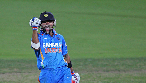 Virat Kohli is ecstatic after completing his century