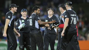 Tarun Nethula is congratulated on dismissing JP Duminy