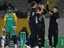 Kyle Mills celebrates his 200th ODI wicket, that of Hashim Amla