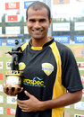 Kishor Bhikane holds a Man of the Match award