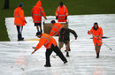 The groundstaff try to mop the water off the covers, New Zealand v South Africa, 1st Test, Dunedin, 5th day, March 11, 2012