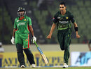 Umar Gul celebrates Nasir Hossain's wicket as Shakib Al Hasan watches, Bangladesh v Pakistan, Asia Cup, Mirpur, March 11, 2012