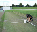 Groundsman Karl Johnson works on the Seddon Park pitch, Hamilton, March 13, 2012