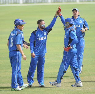 Italy celebrate a wicket against Oman