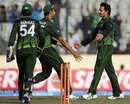Saeed Ajmal celebrates after befuddling Upul Tharanga