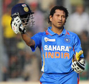 Sachin Tendulkar raised his helmet to the dressing room after reaching his 100th international century