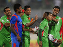 Bangladesh captain Mushfiqur Rahim is surrounded by his players after the win