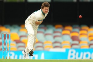 Jackson Bird sends down a delivery, Queensland v Tasmania, Sheffield Shield final, 3rd day, March 18, 2012