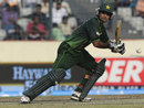 Mohammad Hafeez pushes one into the off side