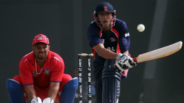 Paras Khadka reverse-sweeps during his half-century
