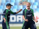Kevin O'Brien and William Porterfield celebrate a wicket, Ireland v Scotland, ICC World Twenty20 Qualifier, Dubai, March 18, 2012