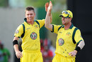 Xavier Doherty high-fives Daniel Christian after dismissing Darren Bravo