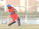 Janeiro Tucker hit three sixes in the final over to beat PNG