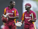 Darren Sammy and Kemar Roach walk off after the match is tied, West Indies v Australia, 3rd ODI, St Vincent, March 20, 2012