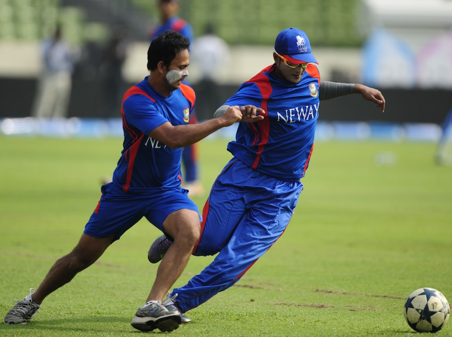Shakib Al Hasan and Nazimuddin play football during a training session on the eve of the Asia Cup