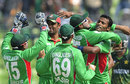 Bangladesh players crowd Nazmul Hossain after taking a wicket, Bangladesh v Pakistan, Asia Cup. final, Mirpur, March 22, 2012
