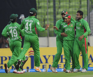 Nasir Hossain is surrounded by team-mates after an impressive catch, Bangladesh v Pakistan, Asia Cup final, Mirpur, March 22, 2012