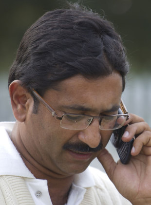 Asif Bajwa, Mohammad Amir's mentor, talks on the phone, Islamabad, November 3, 2011