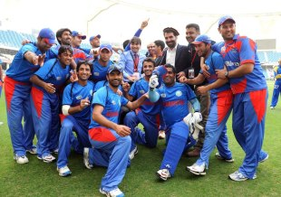 Afghanistan celebrate their win against Namibia and their qualification for the ICC World Twenty20, Afghanistan v Namibia, ICC World Twenty20 Qualifier, Dubai, March 22, 2012