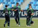 Ireland get together after a wicket