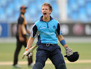Ryan Flannigan roars after getting Scotland the last-ball four they needed against Canada