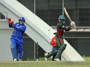 Morris Ouma cuts during his half-century, Italy v Kenya, ICC World Twenty20 Qualifier, ninth-place playoff, Dubai, March 23, 2012