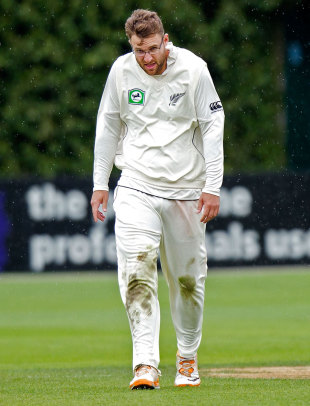 Daniel Vettori walks through the wind and rain, New Zealand v South Africa, 3rd Test, Wellington, 2nd day, March 24, 2012