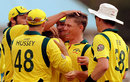 Australia crowd Xavier Doherty after picking up a wicket