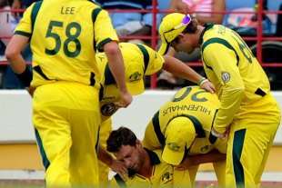Matthew Wade is surrounded by concerned team-mates after colliding with Ben Hilfenhaus, West Indies v Australia, 5th ODI, Gros Islet, March 25, 2012