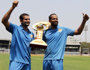Irfan and Yusuf Pathan pose with the Syed Mushtaq Ali Trophy