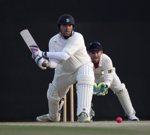 Ian Blackwell reverse sweeps on his way to an unbeaten century for MCC on day 1 of the county season in Abu Dhabi