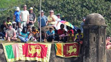 Fans watch the action from the ramparts of the Galle fort