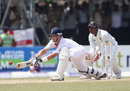 Jonathan Trott reverse sweeps as he tries to lead England's chase
