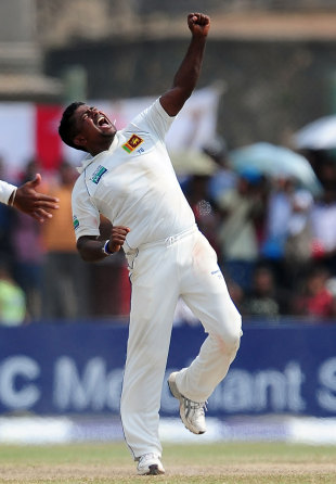 Rangana Herath celebrates his twelfth wicket of the match, trapping Graeme Swann lbw , Sri Lanka v England, 1st Test, Galle, 4th day, March 29, 2012