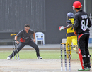 A smart piece of fielding by Kinchit Shah affects the run-out of Uganda's Arthur Kyobe during the 11th Place Play-off match at the ICC World Twenty20 Qualifier played at Sharjah Cricket Stadium on 22nd March 2012