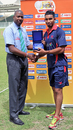 Match Referee Adrian Griffith presents Hong Kong's Irfan Ahmed with his Man of the Match Award after scoring 55* and taking 3-32 during the 11th Place Play-off match against Uganda at the ICC World Twenty20 Qualifier in Sharjah on 22nd March 2012