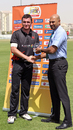 Jamie Atkinson receives his Man of the Match award from Tournament Official Graeme Labrooy after scoring 87* in the ICC World Twenty20 Qualifier match against Bermuda played at the ICC's GCA ground in Dubai on 14th March 2012