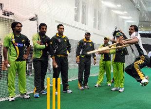 Pakistan players watch Farhan Saeed bowl in the nets, Dubai, February 17, 2012