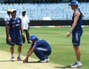 Harbhajan Singh inspects the Chepauk pitch