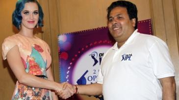 Singer Katy Perry shakes hands with IPL chairman Rajiv Shukla