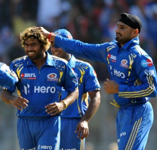 Harbhajan Singh and Lasith Malinga celebrate Manish Pandey's wicket, Mumbai Indians v Pune Warriors India, IPL, Mumbai, April 6, 2012