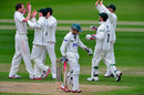 Alan Richardson celebrates with his team-mates after dismissing James Taylor