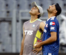 Sourav Ganguly and Harbhajan look up during a practice session