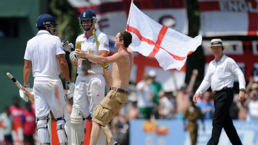 An England fan joins Kevin Pietersen and Alastair Cook in the middle