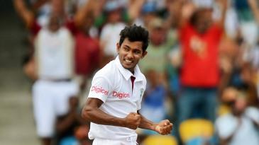 Devendra Bishoo celebrates a wicket