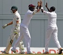 Darren Sammy and Fidel Edwards celebrate Peter Siddle's wicket