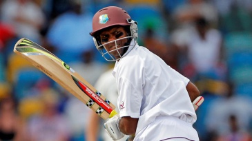 Shivnarine Chanderpaul watches as he is caught behind